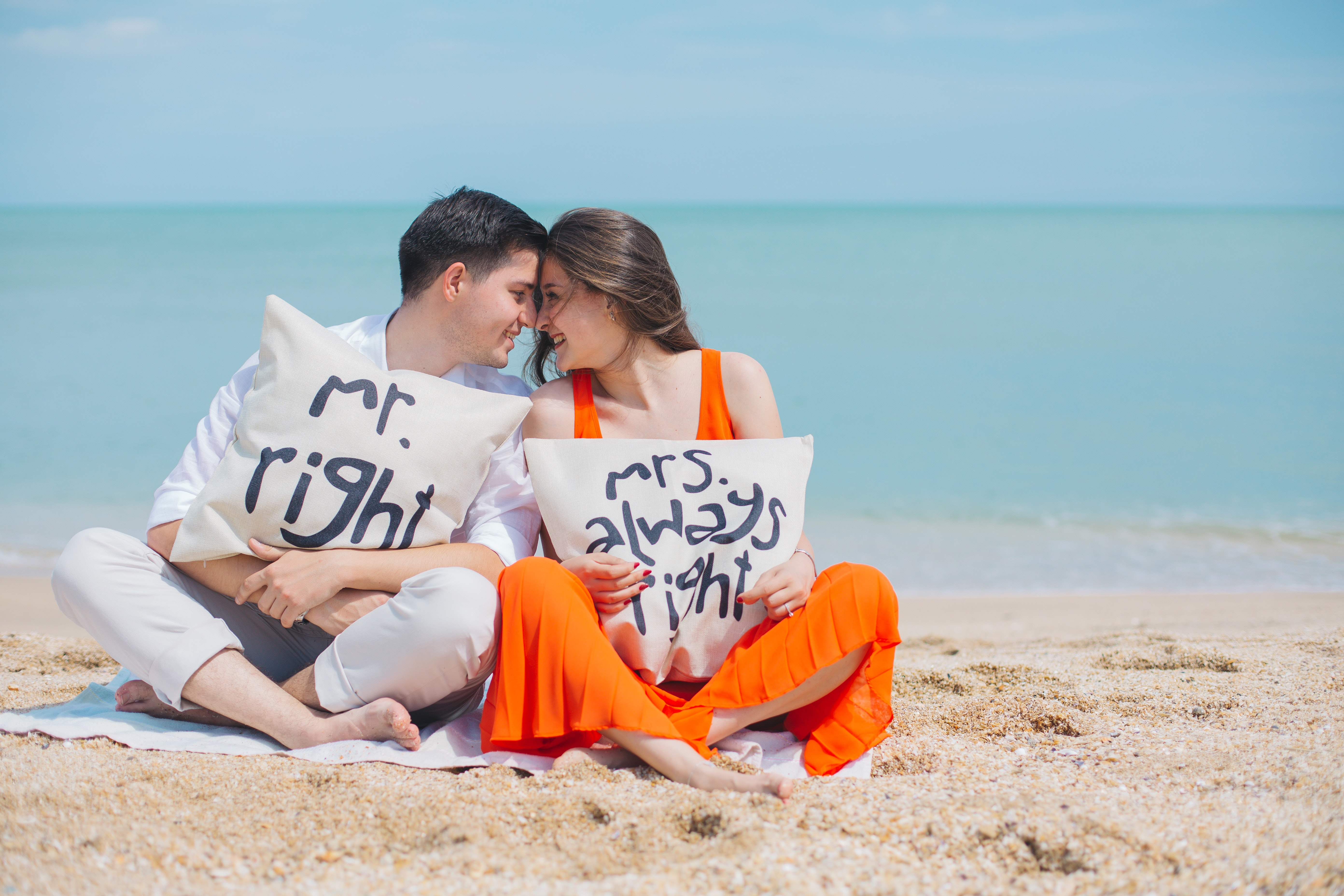 man-and-woman-wearing-cloths-sitting-on-brown-sand-near-792729